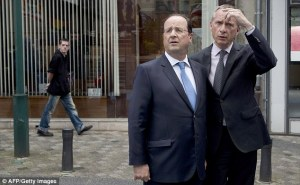French President Francois Hollande left doesn't look too happy today
